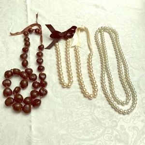 Lot of faux pearl necklaces plus one brown